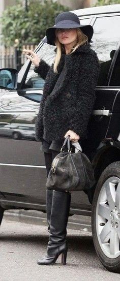 Kate Moss looking cute in her vintage black sheepskin coat.