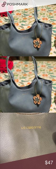 Liz Claiborne shoulder bag brand-new with tags still has paper inside it came from JCPenney's department store I paid $80 for it and it's a beautiful light blue color the pictures make it look gray but  in reality  it is blue I put the measurement on the pictures I have this bag and I am putting a really good price for this bag to move please remember while you're here to check out my closet and my other listings and if you have any questions feel free to contact me and I do except offers…