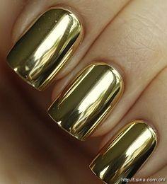 Reflective gold nail polish