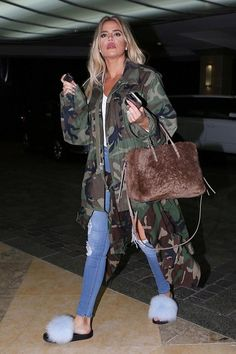Khloe Kardashian wearing Balenciaga Papier A6 AJ Zip-Around Shearling Fur Tote Bag, Confetti Fox Slides in Blue and Camouflage Pablo Jacket