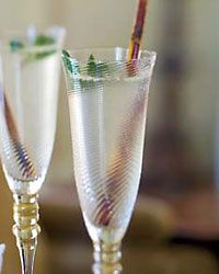 Champagne Mojitos  3/4cup sugar  3/4cup water  1 1/2 cups packed mint leaves, plus 12 mint sprigs, for garnish  6 limes, cut into wedges  2 cups light rum  Cracked ice  3 cups Champagne or sparkling wine  (Directions on how to make this drink on actual site)