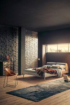Стильная кровать, комод и кресло оригинальной формы - вот и вся мебель в спальне лофт