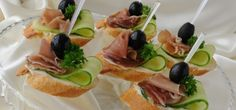 Canapes with ham by Apolonia. Mini sandwiches with ham and cucumber on a baguette Vegetable Appetizers, Finger Food Appetizers, Appetizers For Party, Finger Foods, Tapas, Cheese Ball Recipes, Snack Recipes, Food Design, Party Sandwiches