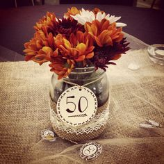 50th wedding anniversary party centerpiece...simple jars, burlap--but a prettier tag.