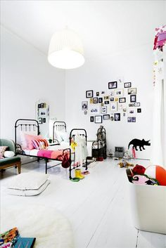 High gloss white painted wood floors  the boo and the boy: Eclectic kids' rooms