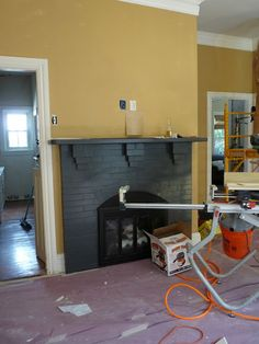 Black fireplace with golden wheat walls