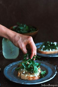 Grilled bread topped off with an arugula-walnut- gorgonzola topping and drizzled with truffle oil. This is an easy-to-make but super delicious appetizer.