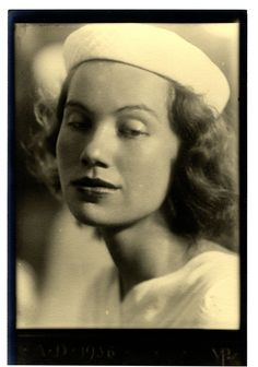 Black and white photograph of Jane Blaffer wearing a white hat, 1936