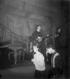 "1962. The Beatles performing at the Star Club during their second tour in Hamburg, Germany. From left to right: John Lennon and  Paul McCartney. The Beatles became the ""house"" band of the club and had to play long and hard, from 8 pm to 4 am. They were paid $500 a week. The Star Club had a capacity up to 1000 and they always packed the club with their loud, brash, fast, rock music Germans loved. #Beatles #1962 #StarClub"