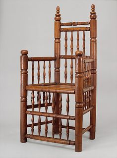 Spindle-back armchair | American | The MetThe rarest and grandest of the early turned chairs are those with rows of spindles below the seat as well as above it. Although its boxlike form may look simple at first glance, this chair is a complex composition with subtle variations in the shaping of the rungs and in the spacing of its horizontal and vertical members. ca. 1640–80
