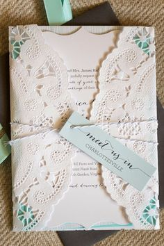 Pretty paper doily wrap for the wedding invitation. ♥