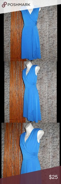 Alyx Limited Blue Faux Wrap Front Drape Dress Sz S Alyx Limited Blue Faux Wrap Front Drape Dress Sz S A charming jersey dress styled in an effortlessly flattering faux-wrap design that's anchored by a draping sash. Extended shoulders and a mock collar add a more sophisticated tone to keep the look work-ready and polished. 95% Polyester, 5% Spandex.   Bust 36.  Shoulder to hem 37. Alyx Dresses Midi