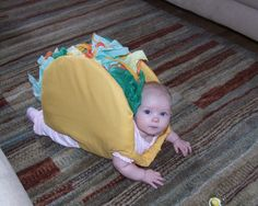 This is a baby dressed as a taco
