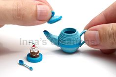 I've been creating three-dimensional quilling recently. This is one of my new miniatures — a quilled tea set and a cupcake with cherry. Quilling Dolls, Paper Quilling Tutorial, Paper Quilling Flowers, Paper Quilling Patterns, Quilling Paper Craft, Quilling 3d, Quilling Designs, Paper Crafts, Quilling Ideas
