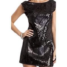 """HP❤️Sequin Mini Dress Host pick! 2/20 by @tketzz   Black dress with sequin pattern in front & plain back with exposed zipper half way down back. High neck front & deep v-cut in back. Cap sleeves. Short hemline. Lined with hint of sheer at the collarbone. NWT. 96% silk 4% spandex. 32"""" from top of shoulder to bottom hem. No damages. Perfect party 🎉 or holiday 🍾 dress! Photos of model are from marcianos website to give you an idea of what the dress looks like on. The dress for sale is in the…"""