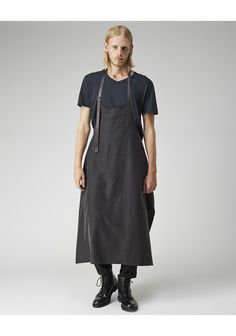"""Apron Dress by Yohji Yamamoto.  Unisex apron-inspired dress with adjustable, tonal leather straps. Model's height is 6'1""""; waist 30""""; suit 40R; shirt 15"""" Worn with / Acne Studios Dublin V-Neck Tee, Comme des Garçons Shirt Man Drop Crotch Pants & Common Projects Combat Boot."""
