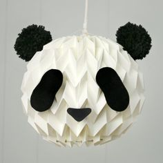 Turn your white paper lanterns into a cute panda, with 2 pompoms and this template!