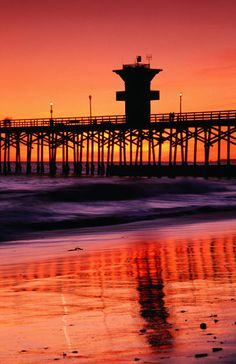"""Seal Beach Pier at sunset."" Photography art prints and posters by Lonely Planet Images - ARTFLAKES.COM"