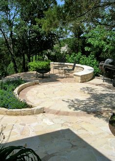 Backyard Stone patio idea and landscaping design.
