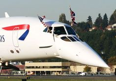 """Concorde: """"The Last Touchdown.""""  (With British: 'Union Jack' Flag & American: 'Stars & Stripes' Flag.)"""