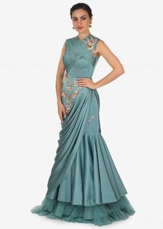 This Turkish blue satin gown is styled with a unique look. The overlapping pleated details on the bodice, the floral motifs in resham work. Girls Formal Dresses, Party Wear Dresses, Trendy Dresses, Nice Dresses, Fashion Dresses, Dress Formal, Wedding Dresses, Western Gown, Western Dresses