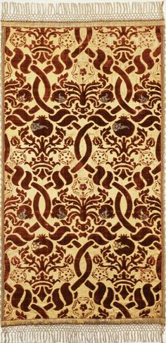 Textile from Italy, Genoa, circa 1500-1525. Textiles; textile lengths Red silk velvet pattern with gold threads on white satin ground; LACMA collections