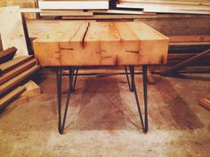 The top of the end table is constructed out of reclaimed wood from a Minnesota barn. The wood is 3.5 thick and finished with multiple coats of lacquer. The