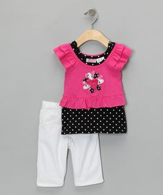For the little one who thinks comfort and style go hand in hand, this set is the perfect match. Ruffles, dots and bitty rosettes combine to highlight a layered look darlings will love.