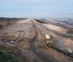 Garzweiler II seen from the panorama viewpoint. The scale of this mine is comparable to a large city.  #GARZWEILER #LIGNITE #MINE #OPEN #CAST #BRAUNKOHLE #BAGGER #LARGE #DEMOLITION #DESTRUCTION #POLITICAL #RWE #ENERGY #CONVEYOR #BELT #MAMIYA #RB #67 #FUJI #PRO #160 #NS #120 #MEDIUM #FORMAT #FILM #DOCUMENTARY #PHOTOGRAPHY