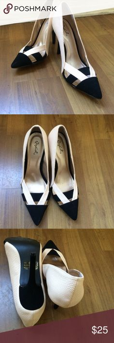SEXY & SOPHISTICATED TWO-TONE POINTED HEELS  Two tone (black & nude almost off white) super comfortable pointed heels! Padding on the inside which makes them easy to walk in! Size 8 1/2 with a little room in the back. Qupid Shoes Heels