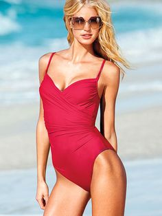 This shaping one-piece with a faux-wrap front is your secret to sleek. Made of innovative, lightweight Miratex® that instantly smooths and sculpts. Look slimmer in seconds with Magicsuit® swimwear, designed exclusively for Victoria's Secret.  Underwire cups  Adjustable straps  Full back coverage  Imported or domestic nylon/Lycra® spandex  Fit tip: Take the next size up for maximum body-shaping benefits.