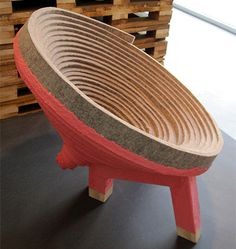 Coiling by Raw Edges: A chair made from rolled wool felt strips covered in acrylic resin for strength.