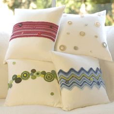 I wish i could make things this pretty. Cream cushions with crochet designs