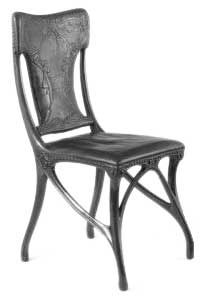 Art Nouveau Chair, 1900.  Carved walnut, upholstered in embossed and stained leather.  This dining chair was shown at the Paris Exhibition of 1900 by the enrepreneur and art dealer Siegfried (Samuel) Bing. In 1895 Bing founded a gallery in Paris, which he called 'L'Art Nouveau', which showed modern design.