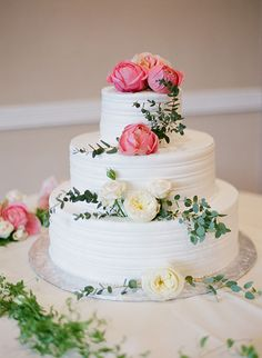 Three Tier White Cake Covered with Flowers | Brides.com