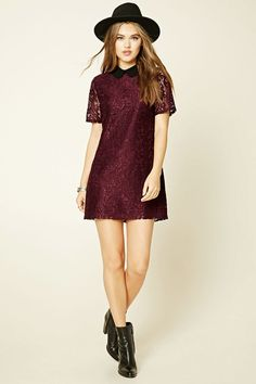 A floral lace dress featuring a contrast collar, shift silhouette, short sleeves, and a concealed back zipper.