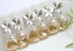 For six sets--not a bad price.  if gold in wedding palette this would be gorgeous!!  Swarovski Golden Champagne Orchid  by tyrahandmadejewelry, $171.00