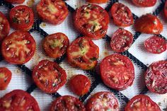 Marinated tomatoes, heading into the dehydrator. From Mouth From the South.