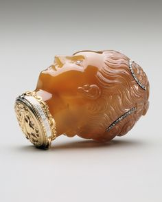 """This box in the shape of a lady's head from around 1760 contains the phrase """"walk in roses and think of me"""" on the gold collar."""