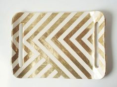 Design buffs will love the graphic styling of this earthenware and gold leaf tray. Each one is made to order, and though not intended for food service, it could be a stylish resting place for keys, mail, or even leftover coins from your travels. —Up in the Air Somewhere, $98