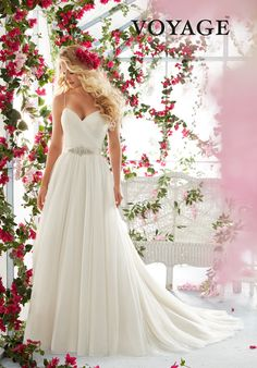 ASYMMETRICALLY DRAPED BODICE WITH SHOESTRING STRAPS ON SOFT NET GOWN