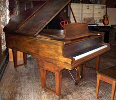 antique baby grand piano