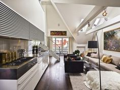 Living Comfortably with Modern Apartment Interior Design: Amazing Modern Elegant Modern Apartment Interior Design Ideas With Hall Areas Dark Wooden Flooring Also Long Gray Sofas And Stairs Decorating Inspiration Completed With Black Arched Lamp ~ punchcopy.com Apartment Inspiration