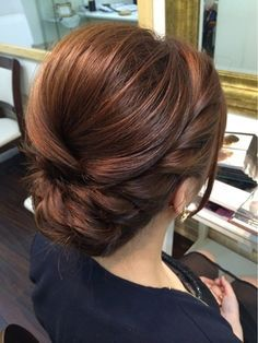 Elegant, polished, braided updo that would be perfect for any bridesmaid or…