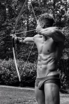 Sexy shirtless man with a bow and arrow in his underwear.