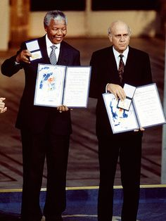 GLOBAL ICON Three years after his release, Mandela receives a Nobel Peace Prize in conjunction with de Klerk, in recognition of their efforts to avoid a South African civil war, joining forces to calm fears and relieve racial tensions. Nelson Mandela Apartheid, African National Congress, Aids Awareness, First Black President, Global Icon, Black Presidents, Singing Happy Birthday, Celebrity Couples, Celebrity Portraits