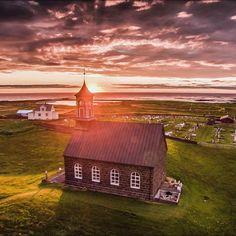 Sunset behind Hvalsneskirkja Reykjanes Iceland build 1887 by ozzophotography