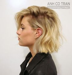Deep side part and blunt cut ends give attitude to a feminine style