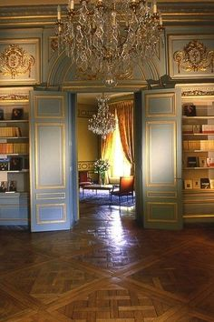French Chateau with lovely paneling and parquet de Versailles