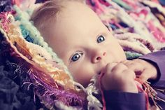I could get lost in this baby's pretty eyes....and the fringe prop behind her is only 45.00 by BabyBirdz (image by Henry Welisch Photography in Villach, Austria at http://www.pix.at  )